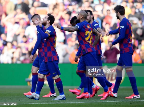 Lionel Messi of FC Barcelona celebrates with teammates after scoring his team's first goal during the La Liga match between FC Barcelona and SD Eibar...