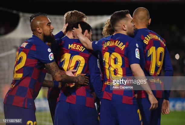 Lionel Messi of FC Barcelona celebrates with teammates after scoring his team's first goal during the La Liga match between FC Barcelona and Real...