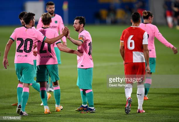 Lionel Messi of FC Barcelona celebrates with teammates after scoring his team's third goal during the pre-season friendly match between FC Barcelona...