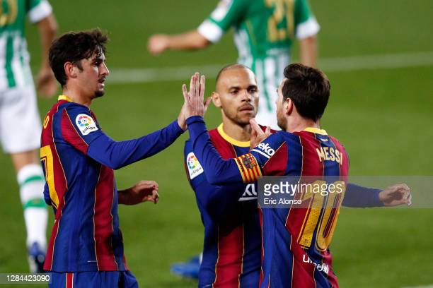 Lionel Messi of FC Barcelona celebrates with teammates after scoring his team's fourth goal during the La Liga Santander match between FC Barcelona...