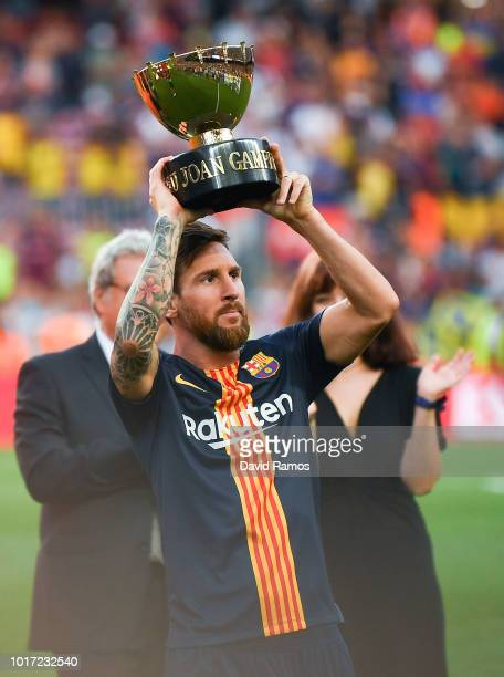 Lionel Messi of FC Barcelona celebrates with the trophy after winning the Joan Gamper Trophy match between FC Barcelona and Boca Juniors at Camp Nou...