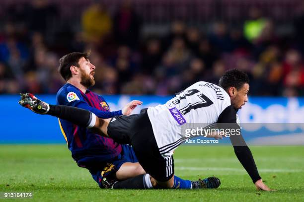 Lionel Messi of FC Barcelona clashes with Francis Coquelin of Valencia CF during the Copa del Rey semifinal first leg match between FC Barcelona and...