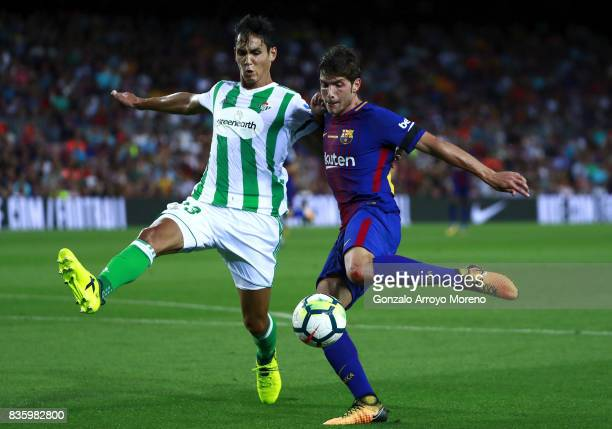 Lionel Messi of FC Barcelona competes for the ball with Aissa Mandi of Real Betis Balompie during the La Liga match between FC Barcelona and Real...