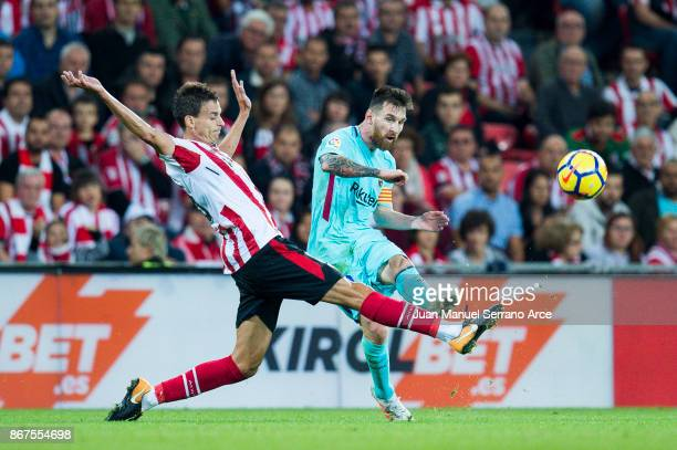 Lionel Messi of FC Barcelona competes for the ball with Ander Iturraspe of Athletic Club during the La Liga match between Athletic Club Bilbao and FC...