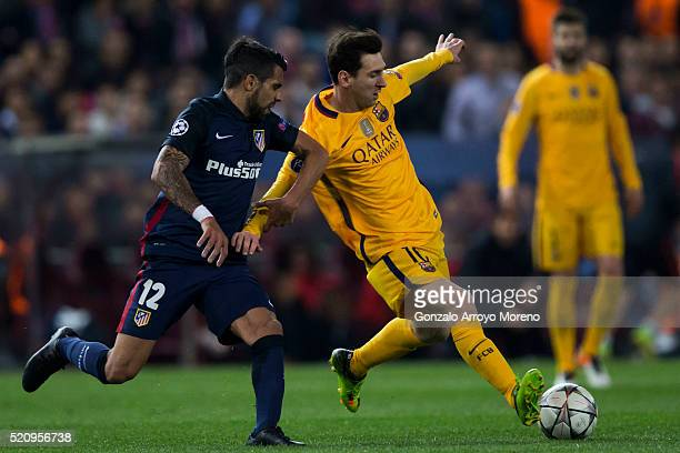 Lionel Messi of FC Barcelona competes for the ball with Augusto Fernandez of Atletico de Madrid during the UEFA Champions League quarter final second...