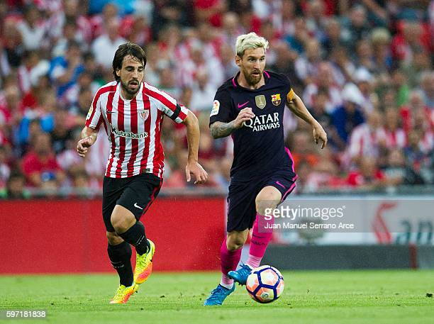 Lionel Messi of FC Barcelona competes for the ball with Benat Etxebarria of Athletic Club during the La Liga match between Athletic Club Bilbao and...