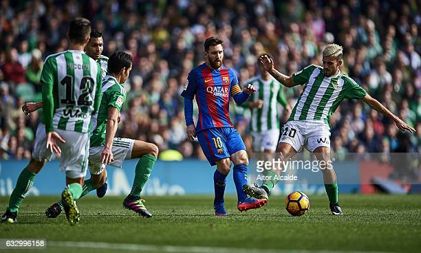 Lionel Messi of FC Barcelona competes for the ball with Dani Ceballos of Real Betis Balompie during La Liga match between Real Betis Balompie and FC...