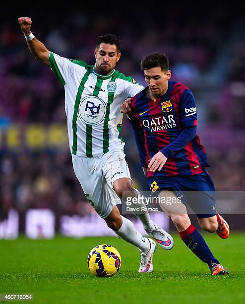 Lionel Messi of FC Barcelona competes for the ball with David Rodriguez Barrera of Cordoba CF during the La Liga match between FC Barcelona and...