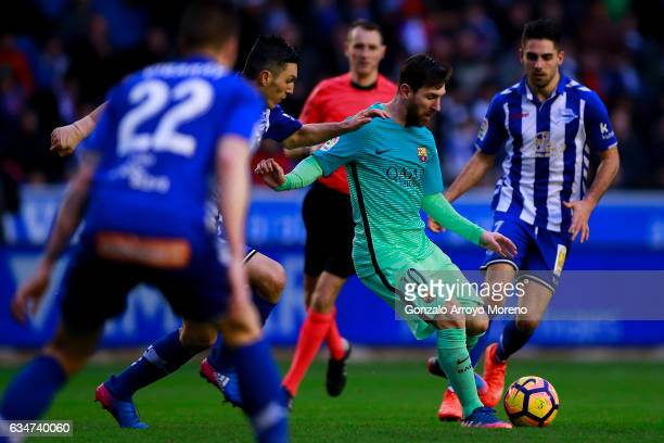 Lionel Messi of FC Barcelona competes for the ball with Edgar Mendez of Deportivo Alaves and his teammate Ruben Sobrino during the La Liga match...