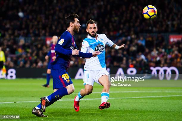 Lionel Messi of FC Barcelona competes for the ball with Emre Colak of Deportivo La Coruna during the La Liga match between FC Barcelona and Deportivo...