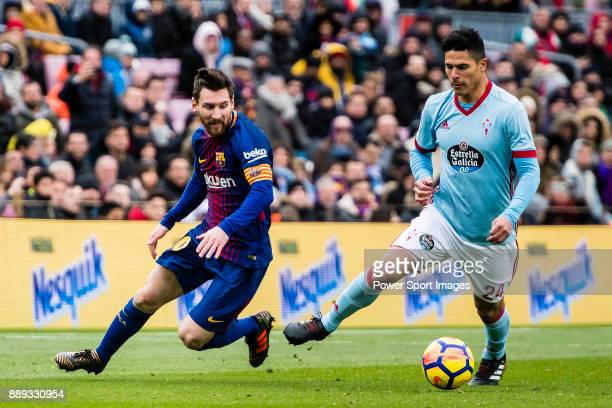 Lionel Messi of FC Barcelona competes for the ball with Facundo Roncaglia of RC Celta de Vigo during the La Liga 201718 match between FC Barcelona...