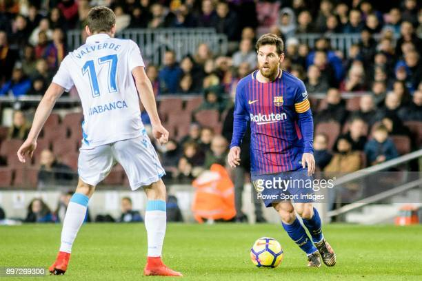 Lionel Messi of FC Barcelona competes for the ball with Federico Valverde Dipetta of RC Deportivo La Coruna during the La Liga 201718 match between...