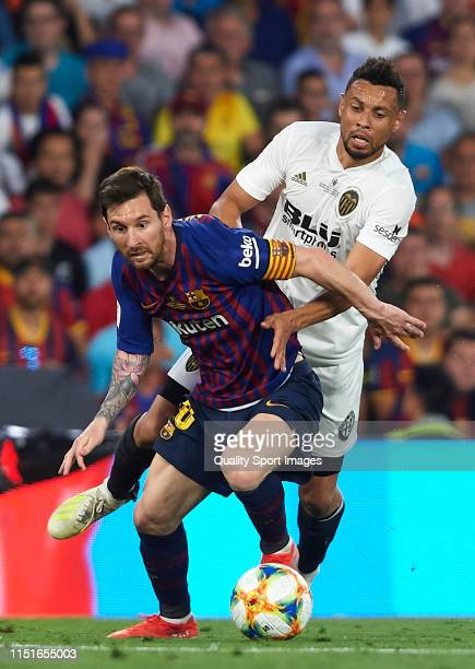 Lionel Messi of FC Barcelona competes for the ball with Francis Coquelin of Valencia CF during the Spanish Copa del Rey Final match between FC...