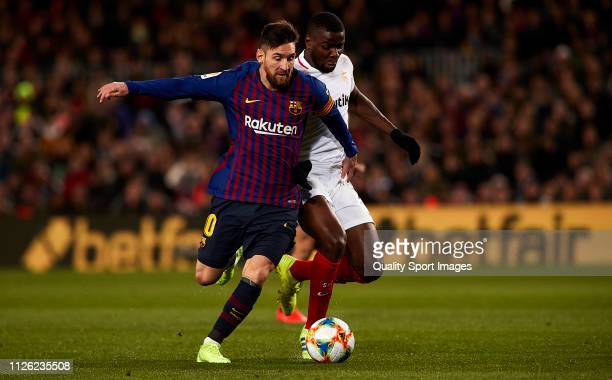 Lionel Messi of FC Barcelona competes for the ball with Ibrahim Amadou of Sevilla during the Copa del Rey second leg Quarter Final match between FC...