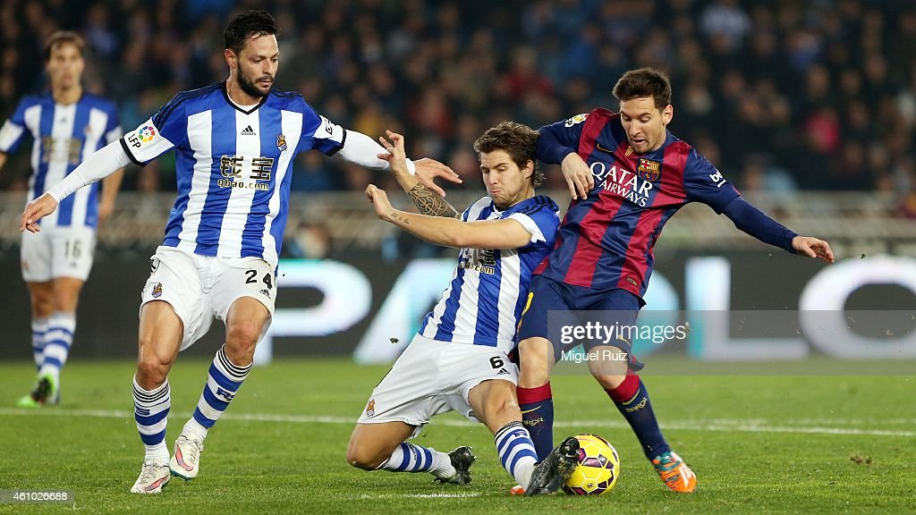 Lionel Messi of FC Barcelona competes for the ball with Iñigo Martinez of Real Sociedad de Futbol during the La Liga match between Real Sociedad de Futbol and FC Barcelona at Estadio Anoeta on January 4, 2015 in San Sebastian, Spain.