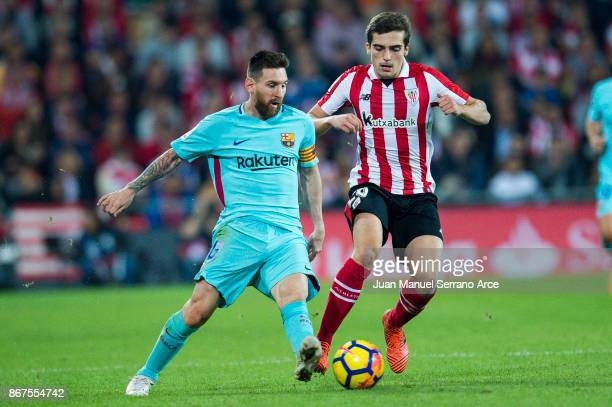 Lionel Messi of FC Barcelona competes for the ball with Inigo Cordoba of Athletic Club during the La Liga match between Athletic Club Bilbao and FC...
