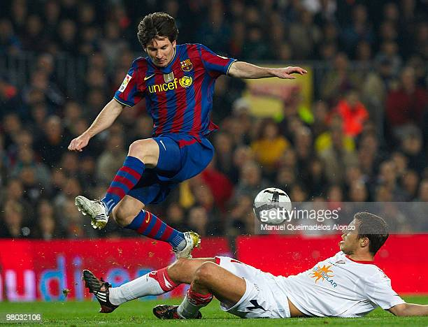 Lionel Messi of FC Barcelona competes for the ball with Krisztian Vad�cz of Osasuna during the La Liga match between Barcelona and Osasuna at the...