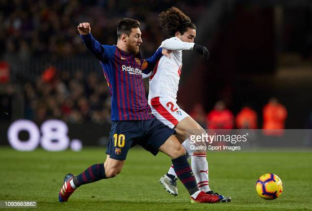 Lionel Messi of FC Barcelona competes for the ball with Marc Cucurella of SD Eibar during the La Liga match between FC Barcelona and SD Eibar at Camp...