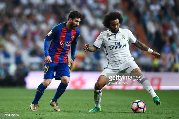 Lionel Messi of FC Barcelona competes for the ball with Marcelo Vieira of Real Madrid CF during the La Liga match between Real Madrid CF and FC...