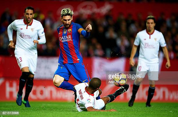 Lionel Messi of FC Barcelona competes for the ball with Mariano Ferreira of Sevilla FC during the match between Sevilla FC vs FC Barcelona as part of...