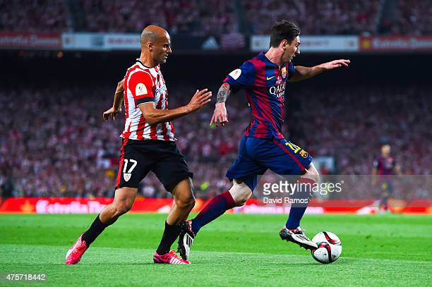 Lionel Messi of FC Barcelona competes for the ball with Mikel Rico of Athletic Club on his way to scores the opening goal during the Copa del Rey...