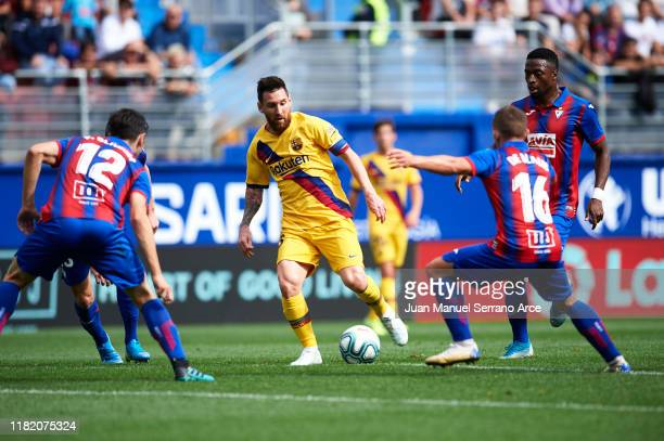 Lionel Messi of FC Barcelona competes for the ball with Paulo Oliveira Pablo De Blasis of SD Eibar during the Liga match between SD Eibar SAD and FC...