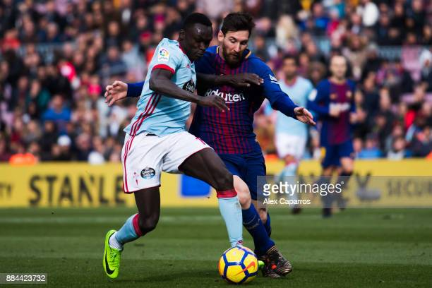 Lionel Messi of FC Barcelona competes for the ball with Pione Sisto of Celta de Vigo during the La Liga match between FC Barcelona and Celta de Vigo...