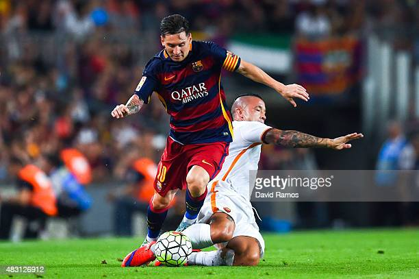 Lionel Messi of FC Barcelona competes for the ball with Radja Nainggolan of AS Roma during the Joan Gamper trophy match at Camp Nou on August 5 2015...