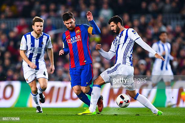 Lionel Messi of FC Barcelona competes for the ball with Raul Navas of Real Sociedad de Futbol during the Copa del Rey quarterfinal second leg match...