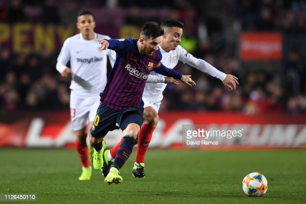 Lionel Messi of FC Barcelona competes for the ball with Roque Mesa of Sevilla FC during the Copa del Quarter Final match between FC Barcelona and...