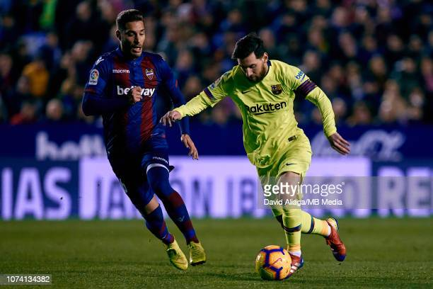 Lionel Messi of FC Barcelona competes for the ball with Ruben Rochina Naixes of Levante UD during the La Liga match between Levante UD and FC...