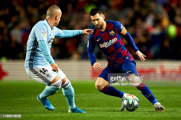 Lionel Messi of FC Barcelona competes for the ball with Stanislav Lobotka of RC Celta de Vigo during the Liga match between FC Barcelona and RC Celta...