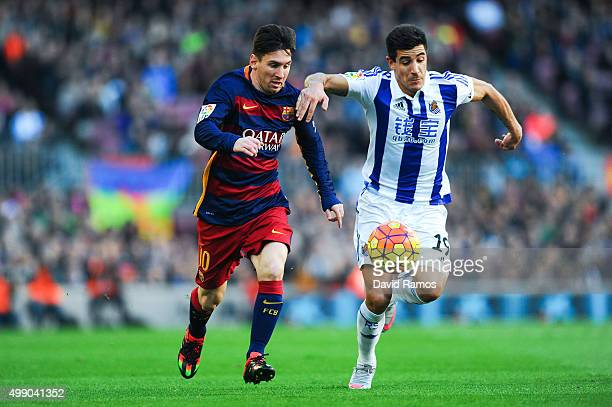 Lionel Messi of FC Barcelona competes for the ball with Yuri Berchiche of Real Sociedad during the La Liga match between FC Barcelona and Real...