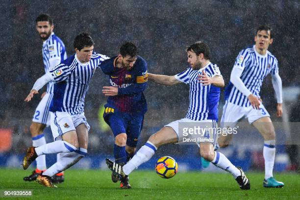Lionel Messi of FC Barcelona competes for the ball withIgor Zubeldia and Asier Illarramendi of Real Sociedad de Futbol during the La Liga match...