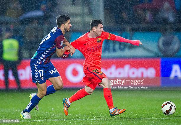 Lionel Messi of FC Barcelona competes with Didac Vila of SD Eibar during the La Liga match between SD Eibar and FC Barcelona at Ipurua Municipal...