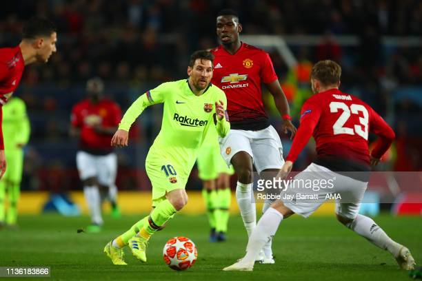 Lionel Messi of FC Barcelona competes with Luke Shaw of Manchester United during the UEFA Champions League Quarter Final first leg match between...