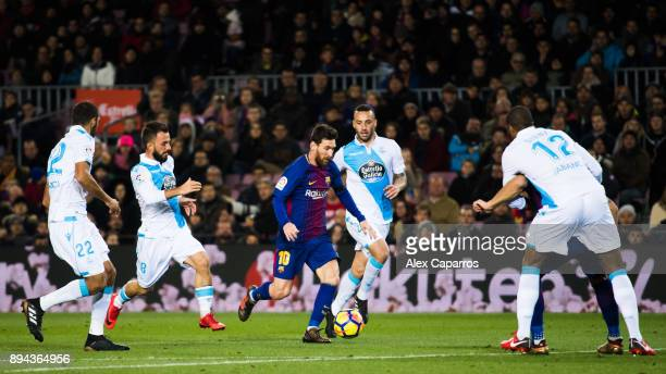 Lionel Messi of FC Barcelona conducts the ball between Celso Borges Emre Colak Guilherme and Sidnei of Deportivo La Coruna during the La Liga match...