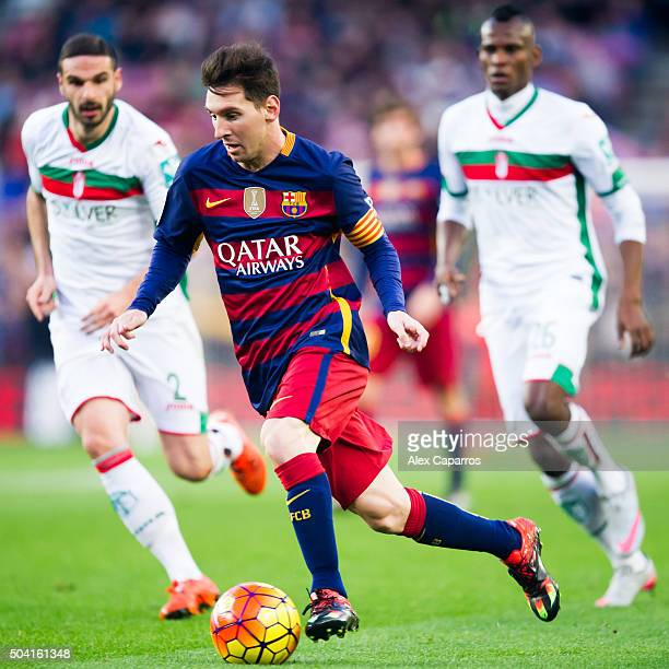 Lionel Messi of FC Barcelona conducts the ball during the La Liga match between FC Barcelona and Granada CF at Camp Nou on January 9 2016 in...