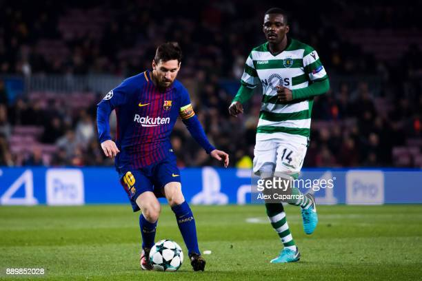 Lionel Messi of FC Barcelona conducts the ball past William Carvalho of Sporting CP during the UEFA Champions League group D match between FC...