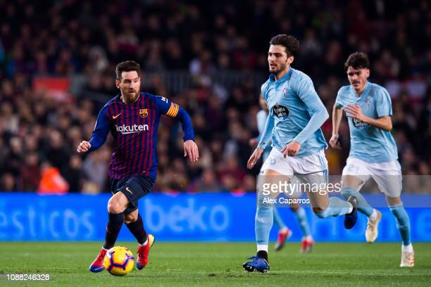 Lionel Messi of FC Barcelona conducts the ball under pressure from Okay Yokuslu of RC Celta de Vigo during the La Liga match between FC Barcelona and...
