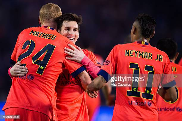 Lionel Messi of FC Barcelona congratulates his teammate Jeremy Mathieu after he scored the opening goal during the La Liga match between Celta Vigo...