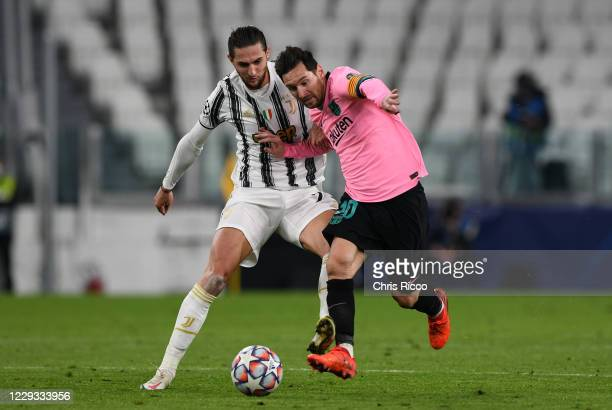 Lionel Messi of FC Barcelona controls the ball against Adrien Rabiot of Juventus during the UEFA Champions League Group G stage match between...