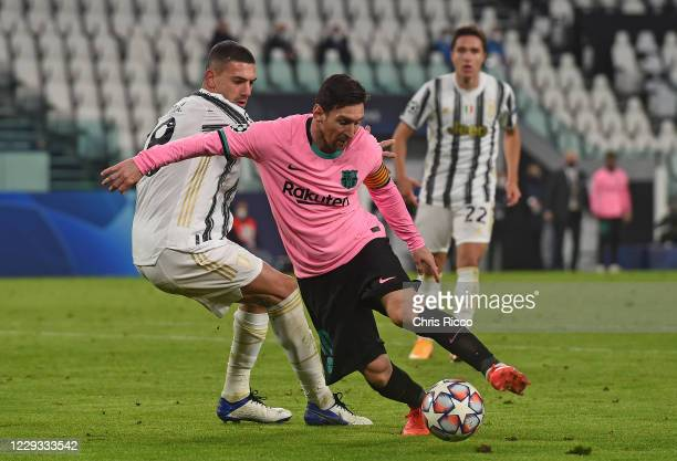 Lionel Messi of FC Barcelona controls the ball against Merih Demiral of Juventus during the UEFA Champions League Group G stage match between...