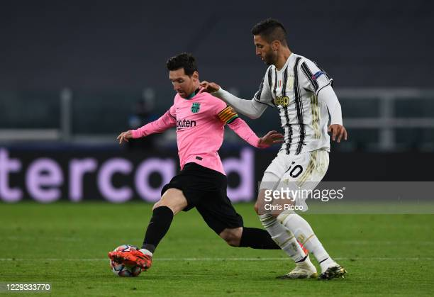Lionel Messi of FC Barcelona controls the ball against Rodrigo Bentancur of Juventus during the UEFA Champions League Group G stage match between...