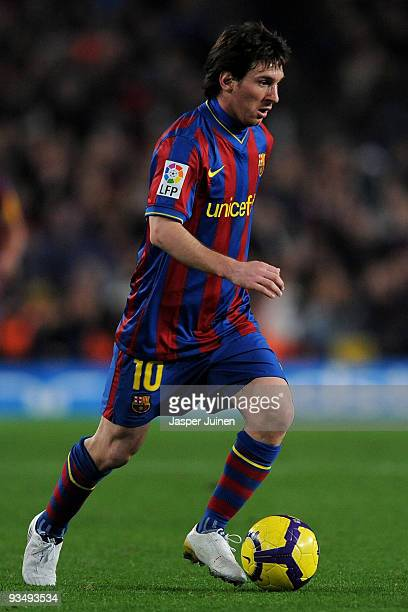 Lionel Messi of FC Barcelona controls the ball during the La Liga match between Barcelona and Real Madrid at the Camp Nou Stadium on November 29 2009...