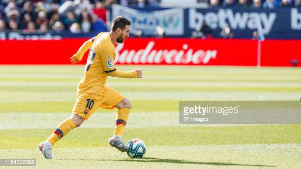 Lionel Messi of FC Barcelona controls the ball during the Liga match between CD Leganes and FC Barcelona at Estadio Municipal de Butarque on November...