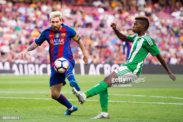 Lionel Messi of FC Barcelona controls the ball next to Charly Musonda of Real Betis Balompie during the La Liga match between FC Barcelona and Real...