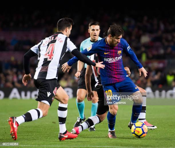 Lionel Messi of FC Barcelona controls the ball next to Rober Pier of Levante UD during the La Liga match between Barcelona and Levante at Camp Nou on...