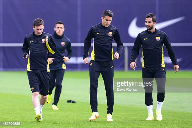 Lionel Messi of FC Barcelona Cristian Tello and Martin Montoya of FC Barcelona warm up during a training session ahead the UEFA Champions League...