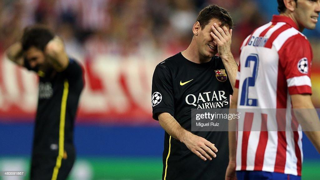 Lionel Messi (C) of FC Barcelona despairs during the UEFA Champions League Quarter Final second leg match between Club Atletico de Madrid and Futbol Club Barcelona at Vicente Calderon Stadium on April 9, 2014 in Madrid, Spain.